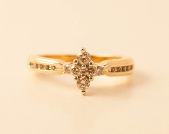 Yellow gold with diamond cluster engagement ring size 7