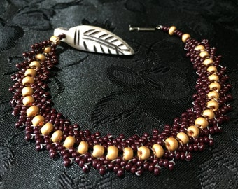 Feather charm beaded bracelet