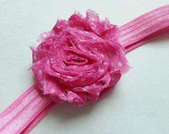 Pink and white polka dot flower baby headband