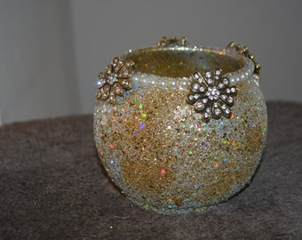 gold and silver, starburst candle holder