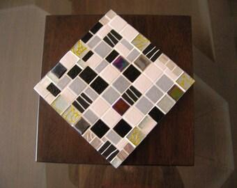 Flat black and white mosaic below