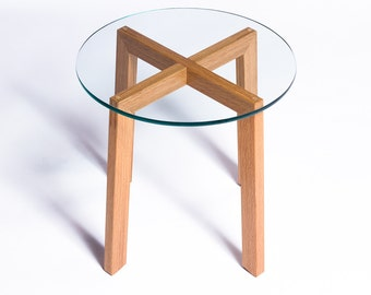 Glass-topped round modern wood end table