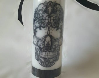 Hand printed lace skull pillar candle with black ribbon