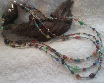 Multi strand glass and gemstone necklace. (23in.)