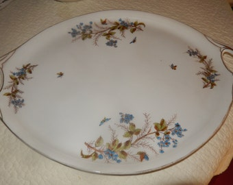 old porcelain plate decorated with myiosotis