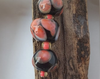 Black and coral glass lampwork beads