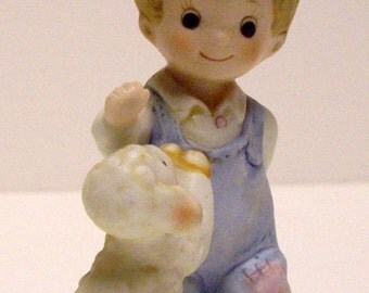 Homco 1449 little boy with lamb is a porcelain figurine