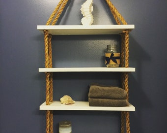 Wooden shelves with rope.