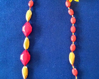 Long gold and coral pink necklace