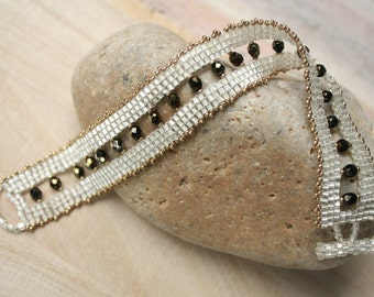 Pearl White Beaded Bracelet With Black Beads and Gold Accents