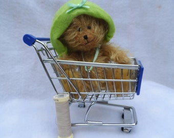 Tracy (is off) her trolley