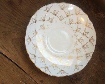 Pretty saucer/plate with gold detailing
