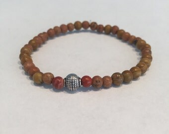 Wood beaded bracelet with two red beads and one silver