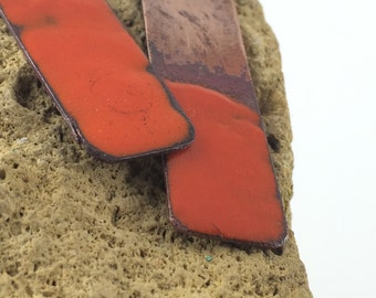 Asymmetrical copper strip with partial flame orange enamel
