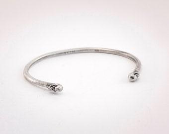 L'instant d'une seconde - adjustable sterling silver bracelet with skull shaped details