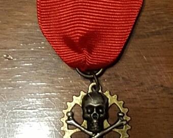 Red skull and crossbones gear medal