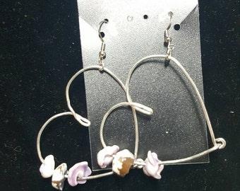 Heart dangle earrings with 3  purple Puka shells