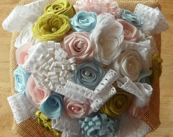 Bridal bouquet fabric with flowers in pastel-colored fabric, burlap and lace