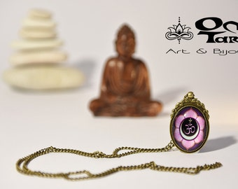 Cabochon and necklace,antique bronze color, 30x40mm(1,18 x 1,57 in)with a lotus and om symbol.Nickel free.Chain lenght 90 cm(35,40 in)