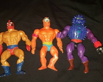 Three 1980s He-man action figures