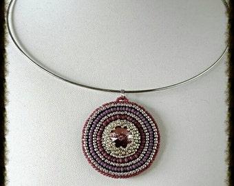 The Central pendant Swarovski embroidery with rivoli