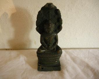 bronze Buddha crowned at the cobra