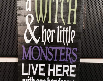 """A Witch and her little Monsters live here with one handsome Devil wood sign. Approximately 6""""x12"""""""
