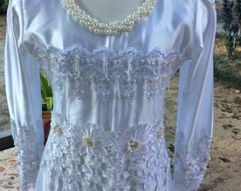Handmade white gown for bridal dress