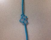 Teal netted sea glass bracelet. White Sea glass
