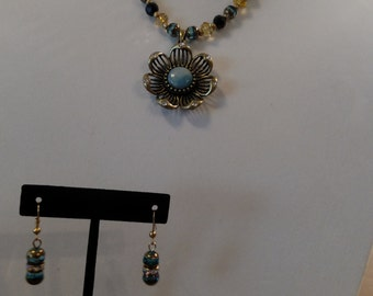 Flower power beaded necklace and earrings.gold tone,black,teal and gold glass beads.gold colored chain with lobster clasp.19 inch long chain
