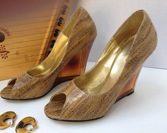 """Shoes, Micheal Antonie,size 7.5  open toe wedge with amber acrylic 4""""heels."""