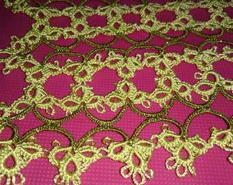 Light yellow with green and gold rectangular doily