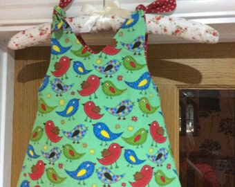 Handmade reversible green Bird print dresses and headbands