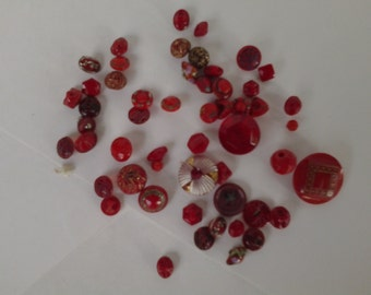 Collection of tiny vintage red glass buttons