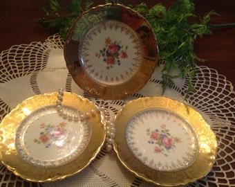 "6.25"" gold gilded floral desert plates, set of three."