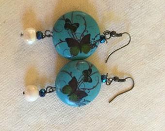 Butterfly pearl earring.