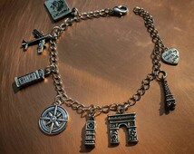 "Handmade wanderlust charm bracelet, adjustable to 8"""