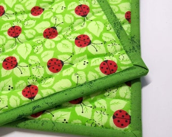 Quilted Fabric Pot Holder, Hot Pad, Trivet, Hostess Gift, Set of two, Lady Bugs on green background