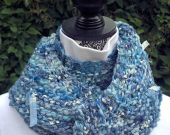 A little shawlette/scarf to keep your shoulders warm. Blue Ribbons shawlette is knit from blue handspun wool yarn and ribbons, OOAK