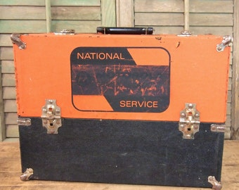 Great old orange and black tool box opens up to reveal compartments hinged lid handle