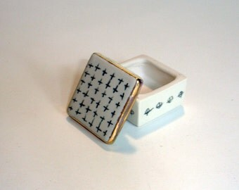 tiny black and white porcelain box with underglaze pencil decoration