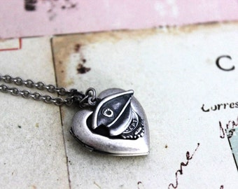policeman. heart locket necklace. in silver ox jewelry with hat and badge charms