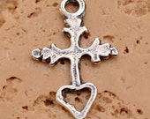Tiny Milagro Cross with Open Heart in Sterling Silver