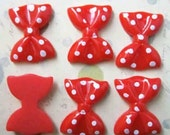 6 red large polka dot plastic bows 1 inch in size for embellishment
