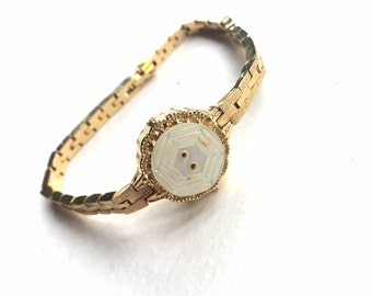 Vintage Button Bracelet with white MOP button and repurposed gold metal watch band