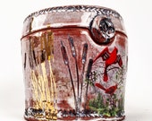 Lidded jar with swamp imagery