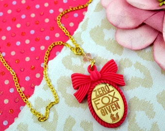 ZERO FOX NECKLACE -Gold Etched Laser Cut Acrylic Center in Hot Pink Bow Setting