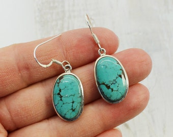 Nice stone Freeform blue spider web Turquoise earrings set on 925e sterling silver, dangling type with hooks