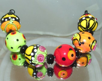 Red Hot Summer. 18mm Rounds. Lampwork beads