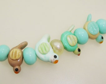 Handmade Lampwork Beads - Flyover! 9 bead set. 4 birds, greens & tans, 5 accent beads.